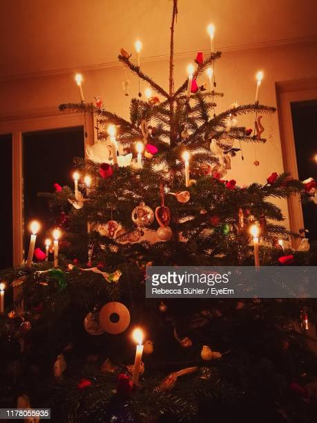 illuminated christmas tree at night - christmas decore candle stock pictures, royalty-free photos & images