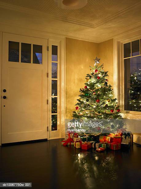 illuminated christmas tree in entrance hall - christmas tree stock pictures, royalty-free photos & images