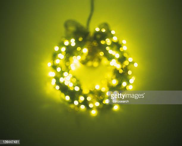 Illuminated Christmas wreath, front view, soft focus