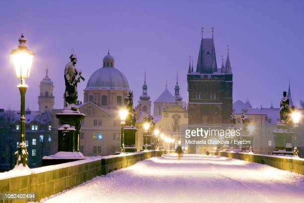 illuminated church in city at night during winter - czech republic stock pictures, royalty-free photos & images