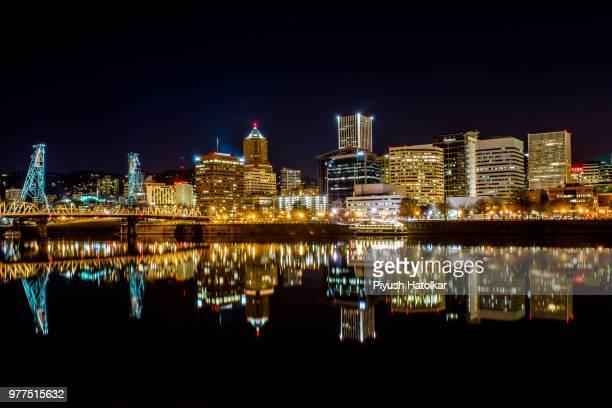 Illuminated city across water, Portland, Oregon, USA