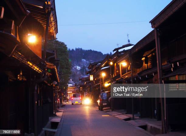 illuminated city against clear sky at night - takayama city stock pictures, royalty-free photos & images