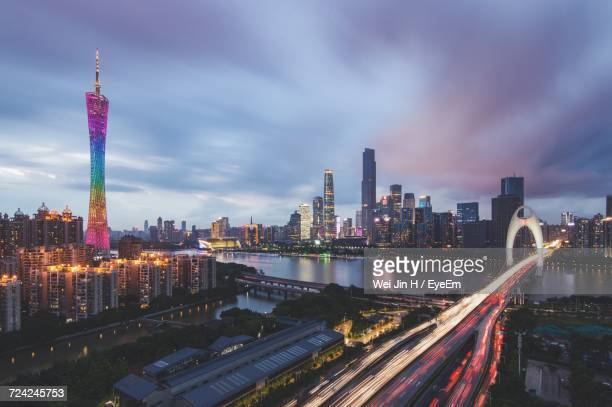 illuminated city against sky at night - guangdong province stock photos and pictures