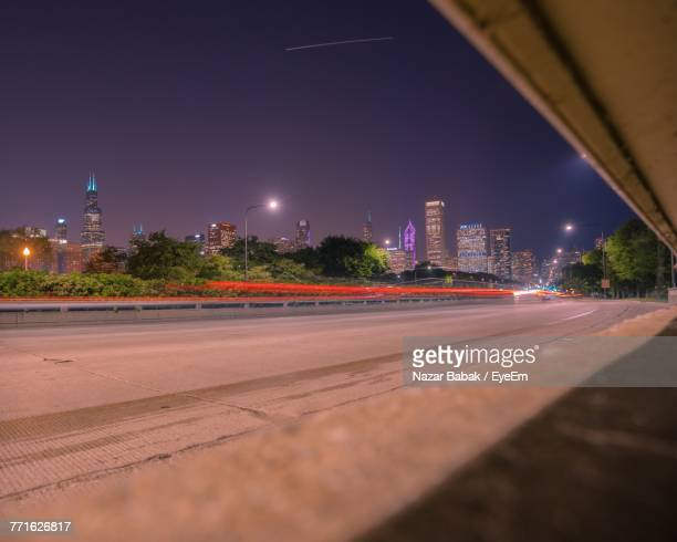 illuminated city against sky at night - nazar stock photos and pictures