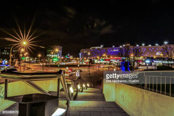 illuminated city against sky at night - essen germany stock pictures, royalty-free photos & images