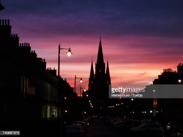 illuminated city against sky at sunset - edinburgh stock pictures, royalty-free photos & images