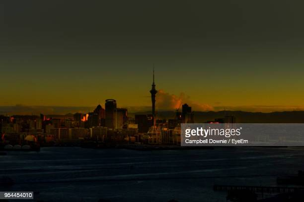 illuminated city against sky during sunset - campbell downie stock pictures, royalty-free photos & images