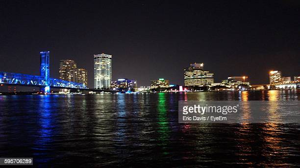 Illuminated City And Main Street Bridge By St Johns River Against Sky