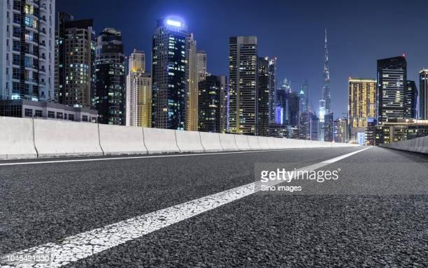 illuminated city at night, dubai - image stock pictures, royalty-free photos & images