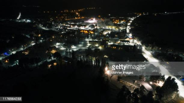 illuminated city at night - norrbotten province stock pictures, royalty-free photos & images