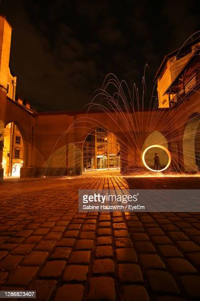illuminated city at night - sabine hauswirth stock pictures, royalty-free photos & images