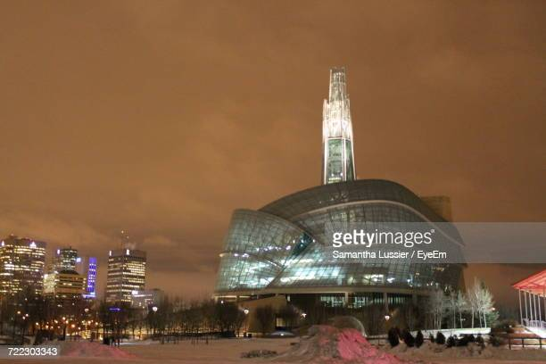 illuminated city at night - winnipeg stock pictures, royalty-free photos & images