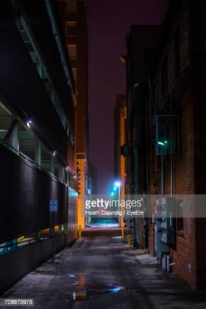 illuminated city at night - alley stock pictures, royalty-free photos & images