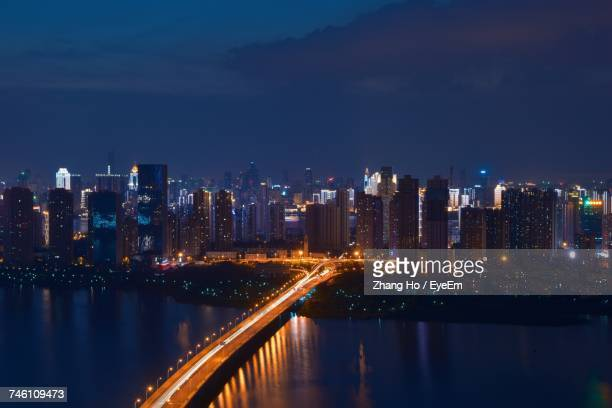 illuminated city at night - wuhan stock photos and pictures