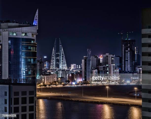 illuminated city at night - bahrain stock pictures, royalty-free photos & images