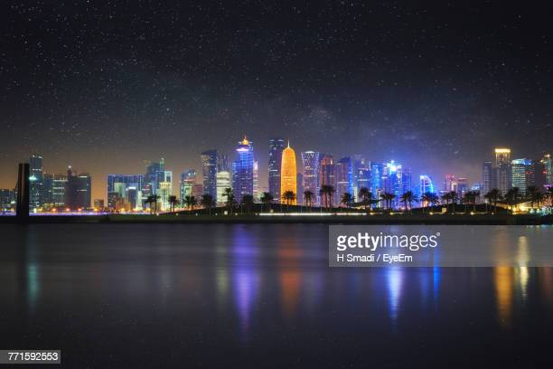 illuminated city at night - doha stock pictures, royalty-free photos & images