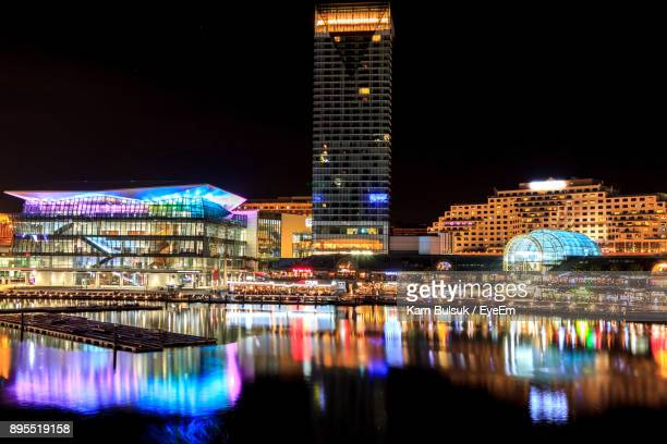 illuminated city at night - darling harbour stock pictures, royalty-free photos & images