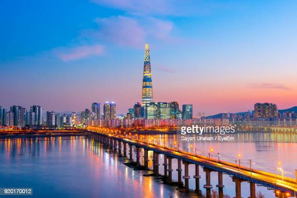 illuminated city at night - seoul stock pictures, royalty-free photos & images