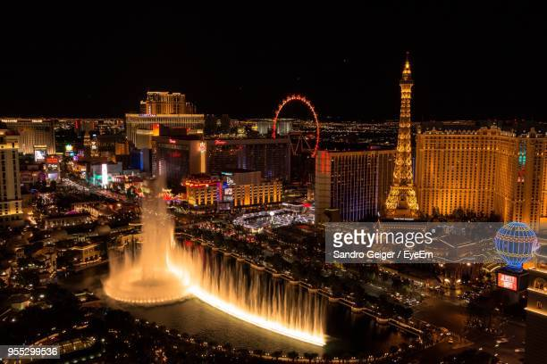 illuminated city at night - las vegas stock pictures, royalty-free photos & images