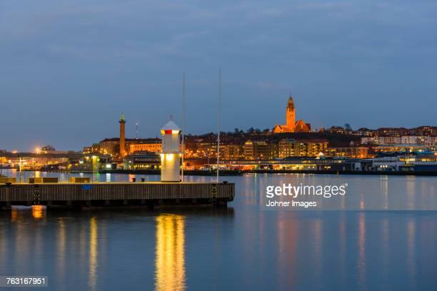 Illuminated city at sea