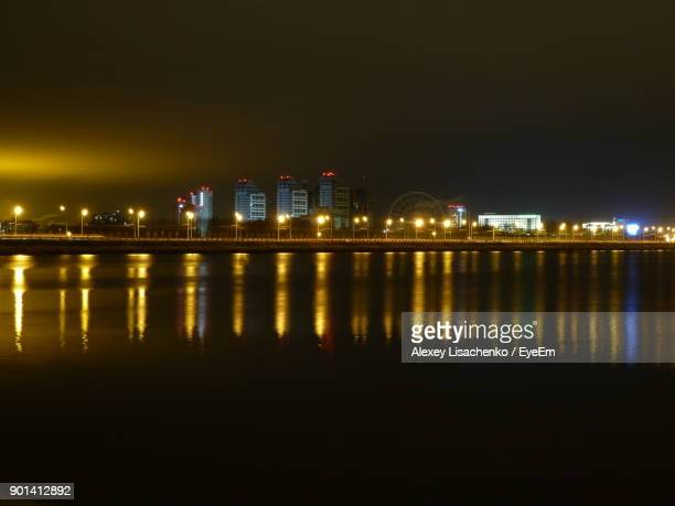 illuminated city at waterfront at night - kazan russia stock pictures, royalty-free photos & images
