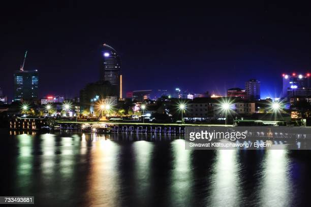 illuminated city at waterfront - phnom penh stock pictures, royalty-free photos & images