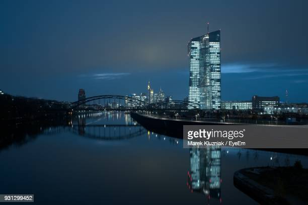 illuminated city at waterfront - frankfurt main stock pictures, royalty-free photos & images