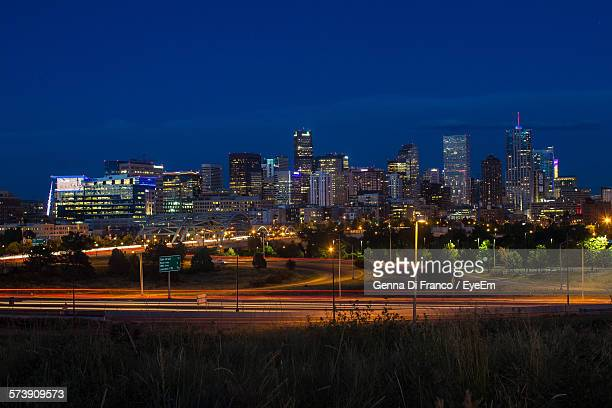 illuminated city buildings against blue sky - westminster maryland stock pictures, royalty-free photos & images