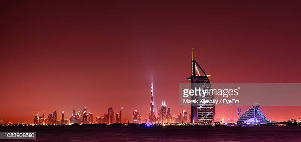 illuminated city buildings at night - tower stock pictures, royalty-free photos & images