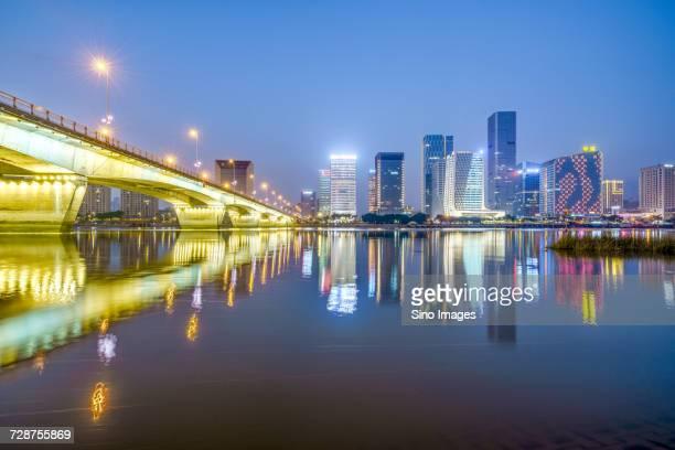 Illuminated city reflected in water, Fuzhou, Fujian, China