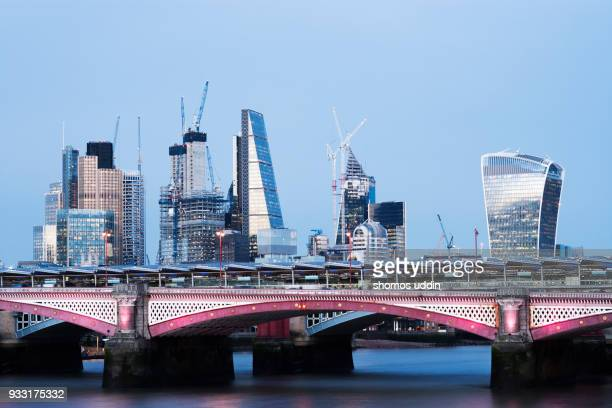 illuminated city skyline of london financial centre at twilight - 2018 stock pictures, royalty-free photos & images