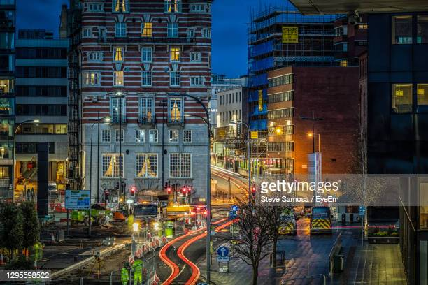 illuminated city street and buildings at night - liverpool stock pictures, royalty-free photos & images