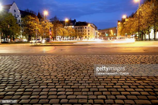 illuminated city street at night - sabine hauswirth stock pictures, royalty-free photos & images
