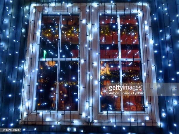 illuminated city windows at night - decoration stock pictures, royalty-free photos & images