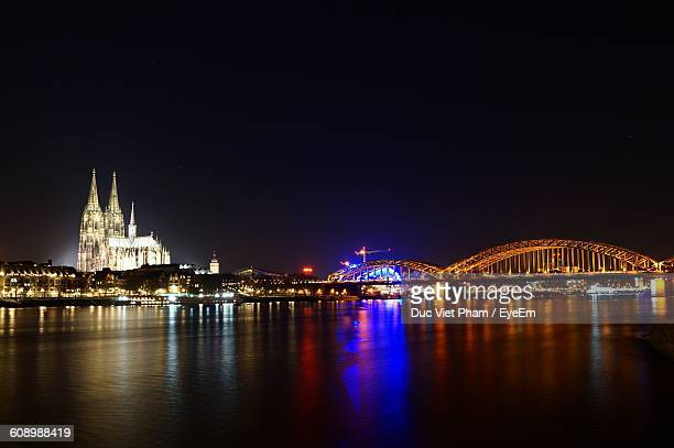 Illuminated City With Rhine River Against Clear Sky