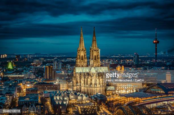 illuminated cityscape against sky at dusk - cologne stock pictures, royalty-free photos & images