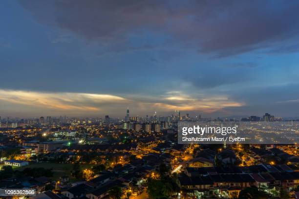 illuminated cityscape against sky at dusk - shaifulzamri ストックフォトと画像