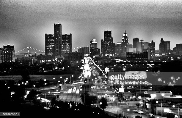 illuminated cityscape against sky at dusk - detroit skyline stock pictures, royalty-free photos & images
