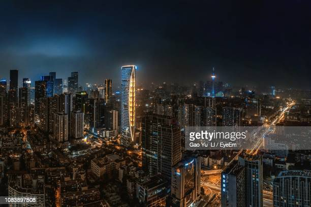 illuminated cityscape against sky at night - haikou stock pictures, royalty-free photos & images