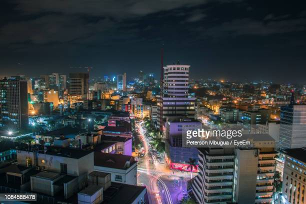 illuminated cityscape against sky at night - kenia fotografías e imágenes de stock
