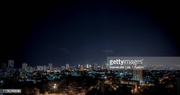 illuminated cityscape against sky at night - maputo city stock pictures, royalty-free photos & images