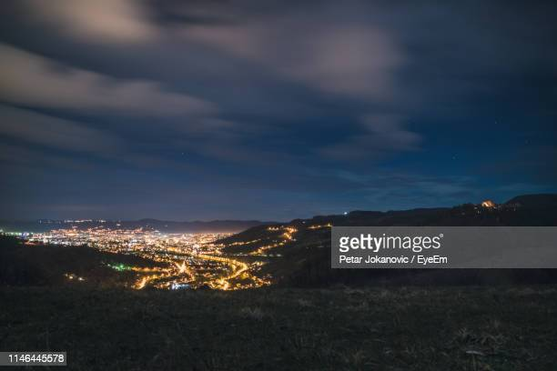 illuminated cityscape against sky at night - distant stock pictures, royalty-free photos & images