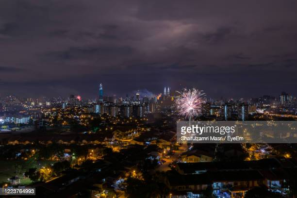 illuminated cityscape against sky at night - shaifulzamri stock pictures, royalty-free photos & images