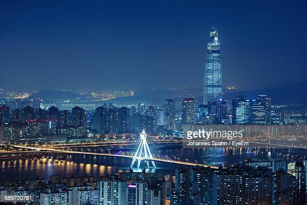 illuminated cityscape against sky at night - seoul stock pictures, royalty-free photos & images