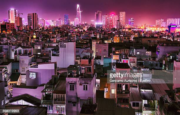 illuminated cityscape against sky at night - ho chi minh city stock pictures, royalty-free photos & images