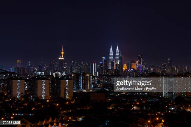 Illuminated Cityscape Against Sky At Night