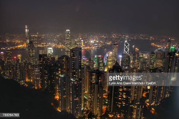 illuminated cityscape against sky at night - cebu stock photos and pictures