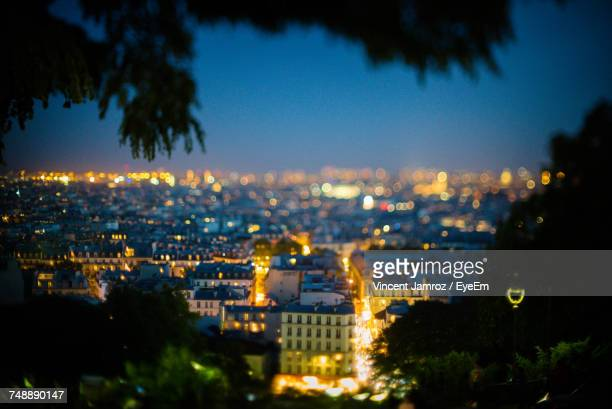 illuminated cityscape against sky at night - ile de france stock pictures, royalty-free photos & images