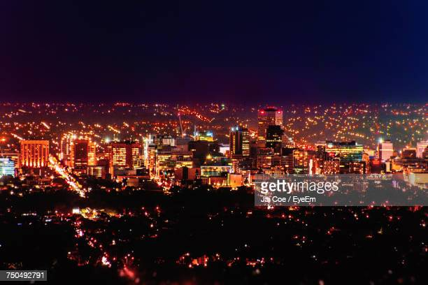 illuminated cityscape against sky at night - adelaide stock pictures, royalty-free photos & images