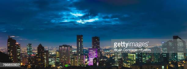 illuminated cityscape against sky at night - bogota stock pictures, royalty-free photos & images